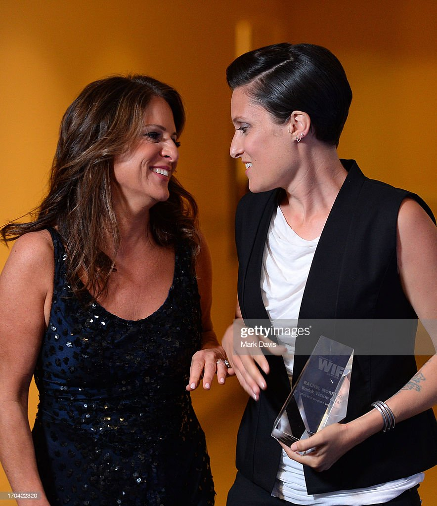 Women in Film President Cathy Schulman (L) and cinematographer Rachel Morrison (holding the Kodak Vision Award) attend Women In Film's 2013 Crystal + Lucy Awards at The Beverly Hilton Hotel on June 12, 2013 in Beverly Hills, California.