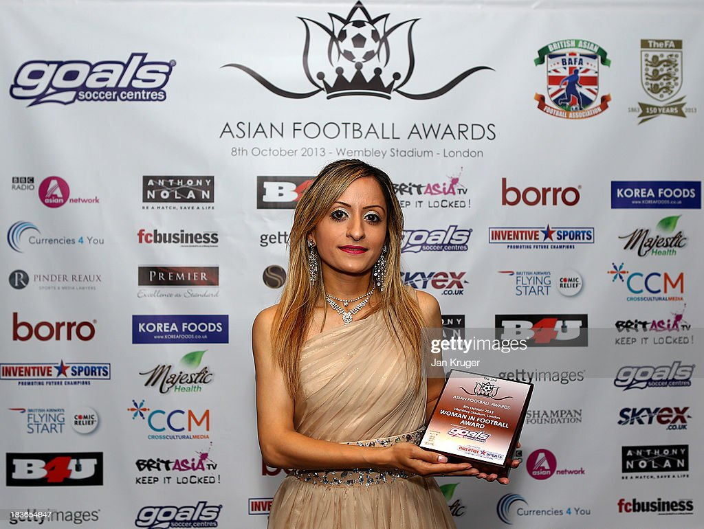 Women in Football award winner Manisha Taylor poses during the Second Annual Asian Football Awards at Wembley Stadium on October 8, 2013 in London, England.