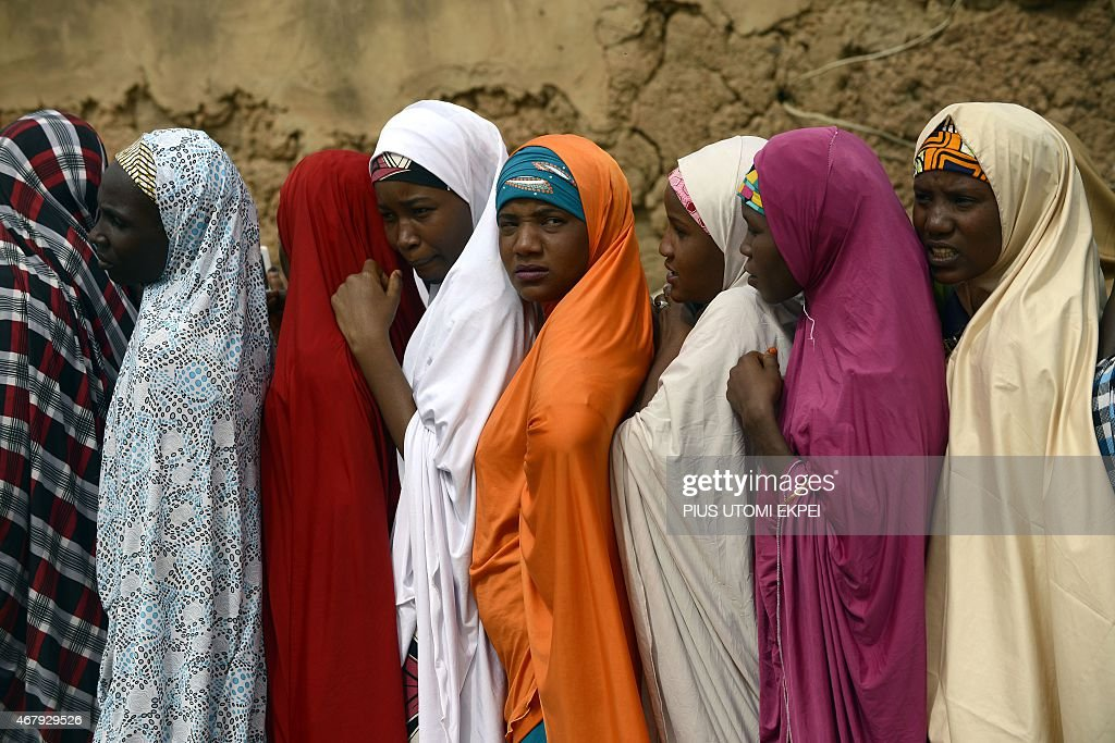 Women in khimars wait in line to cast their votes at a polling station in Daura Katsina State during presidential elections on March 28 2015 Voting...