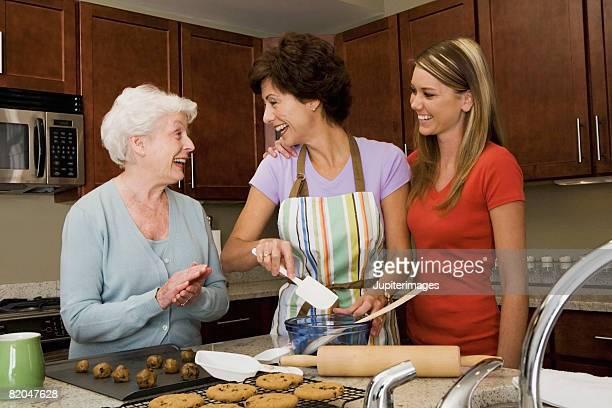 Women in kitchen baking cookies