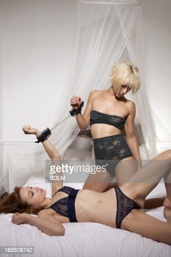Women in lingerie in bed together