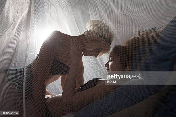 Women in lingerie touching each other