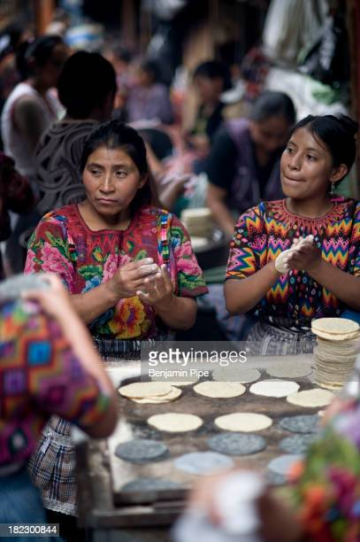 CONTENT] Women in Market preparing TortillaS Chichicastenango Western Highlands Guatemala Central America