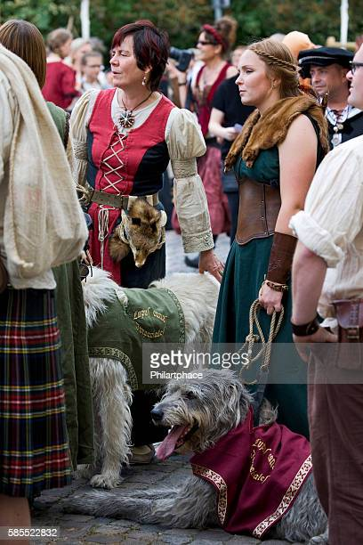 women in medieval costumes with deerhound at Luther's Wedding Wittenberg