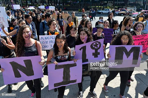 Women in Mexico City take part on October 19 2016 in a march in solidarity for the brutal killing of a 16yearold girl in Argentina where protesters...
