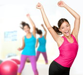 Fitness dance zumba class aerobics. Women dancing happy energetic in gym fitness class.