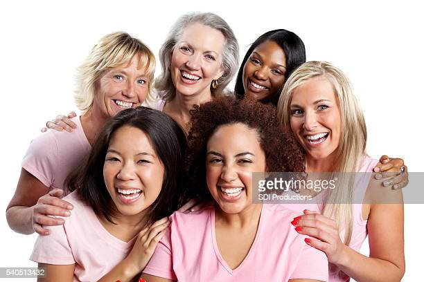 Women in pink embracing