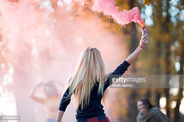 Women in pink smoke