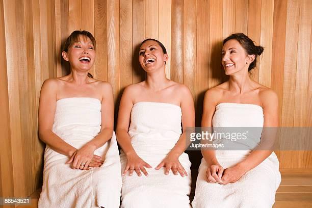 Women in sauna laughing