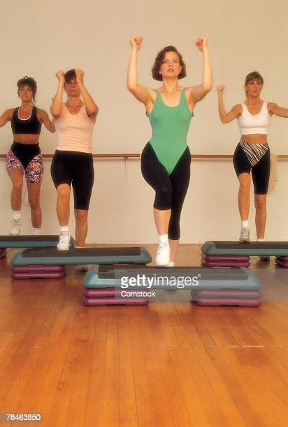 Women in step aerobics class
