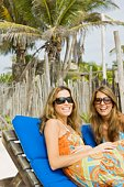 Women in sunglasses on beach