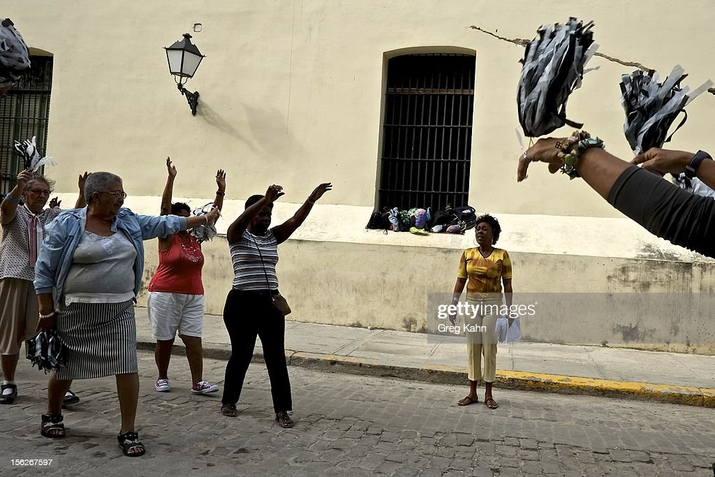 Women in the 'Circulo de Abuelos,' one of many exercise groups for senior women, goes through a routine in Old Havana on November 12, 2012 in Havana, Cuba. These groups, part of a government social program for seniors, meets daily. New business regulations in the communist country have allowed thousands of citizens to make money for themselves for the first time since 1959.