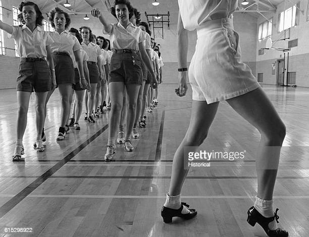 Women in the gymnasium at Iowa State College in Ames Iowa learn how to tap dance May 1942