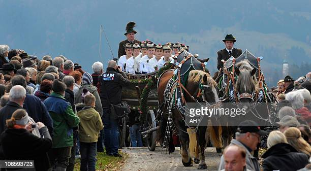 Women in the traditional attire of the Bavarian highlands and fox furs on their way to the Leonhardi Chapel during the annual horse and coach...