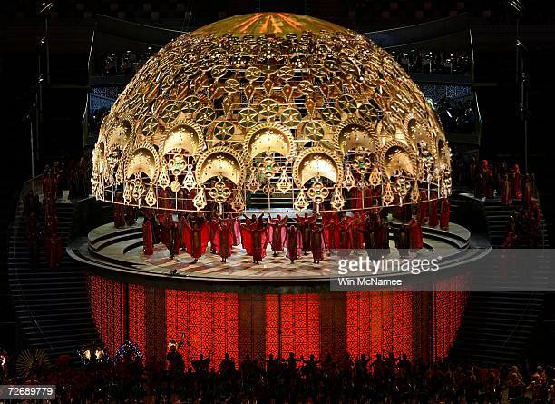 Women in traditional Arabic dress perform beneath a representation of a giant astrolabe during a rehearsal at Khalifa Stadium for the Opening...