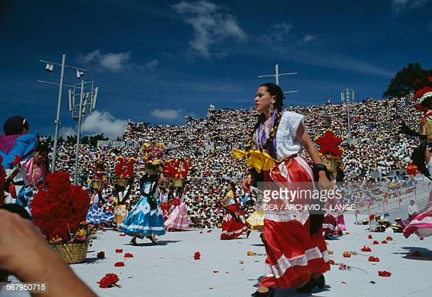 Women in traditional costumes during the celebrations at the Guelaguetza festival Oaxaca Mexico
