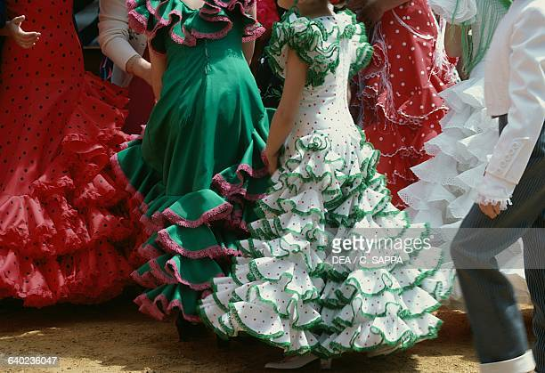 Women in traditional costumes during the Seville April fair Andalusia Spain