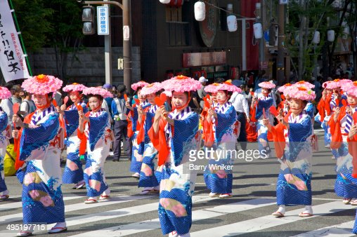 Women in traditional costumes marching in parade