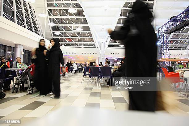Women in traditional dress shopping at a mall, Jeddah, Saudi Arabia