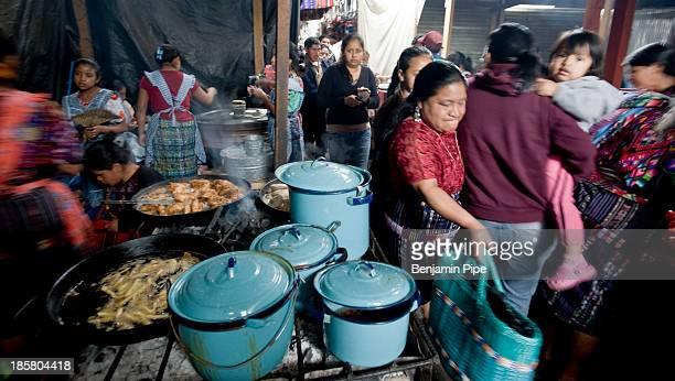 CONTENT] Women in traditional dress working in Market Chichicastenango Western Highlands Guatemala