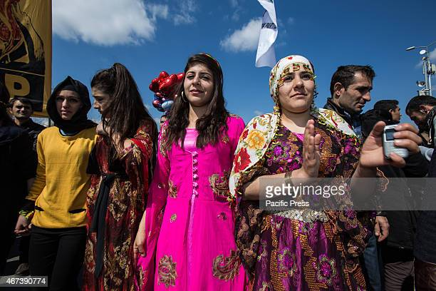 Women in traditional Kurdish costume at Newroz celebration rally