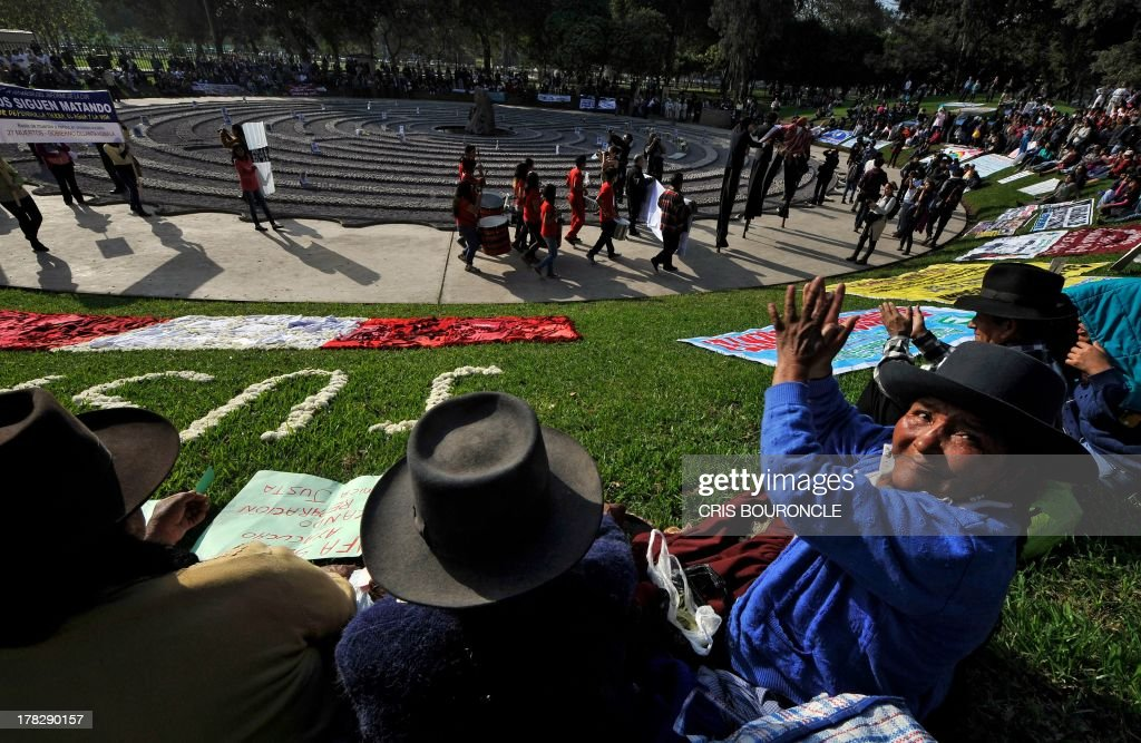 Women in typical Andean attires participate in a ceremony for victims of the war against terrorist groups as The Shinning Path and the Tupac Amarus during the 80's and 90's, at a symbolic graveyard in Lima on August 28, 2013. Relatives of victims commemorate the 10th anniversary of the release of the report of the Commission of Truth and Reconciliation of Peru, which concluded that there were 69.000 people killed or missing during the 80's and 90's. AFP PHOTO/CRIS BOURONCLE