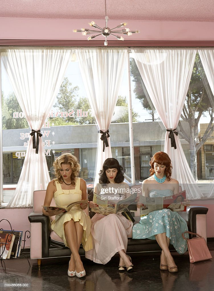 Women in vintage clothing waiting inside beauty salon : Stock Photo