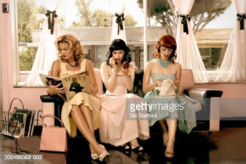 Women in vintage clothing waiting inside beauty salon