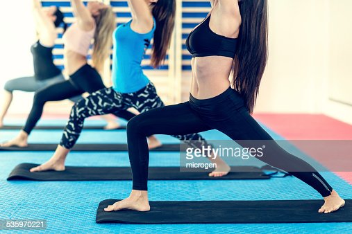 Women in Warrior 1 pose : Stock Photo