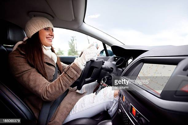 Women inside of the car, using navigational equipment