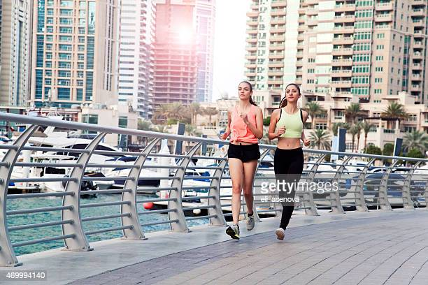 Women jogging in Dubai Marina.