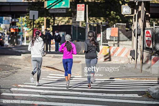 Women jogging on crossroad in morning