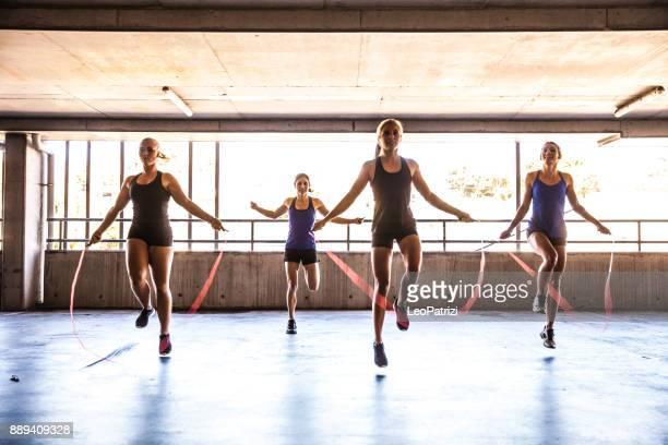 Women jumping rope during boxing training
