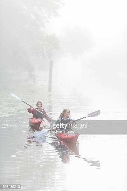 Women kayaking in fog
