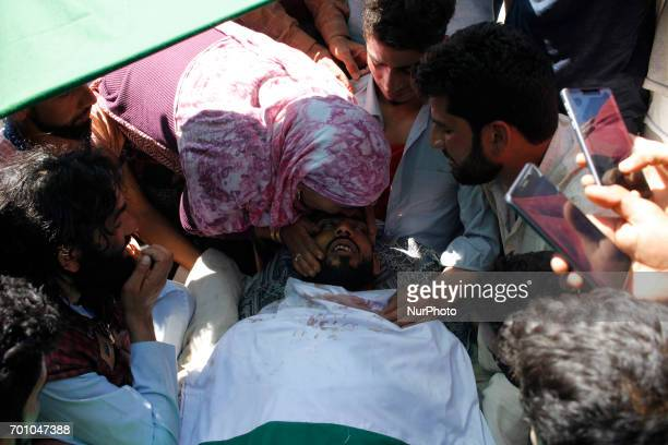 A women kisses the Body of Tauseef AhmedA civilian during his funeral in Tengpun south of Srinagar Indian Administrated Kashmir June 22 2017 Tauseef...