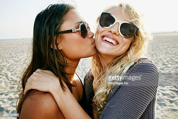 Women kissing on beach