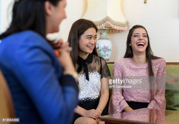 Women laugh during a lesson at the Switzerland's last finishing school Institut Villa Pierrefeu on June 26 2017 in Glion Eight women sit primly...