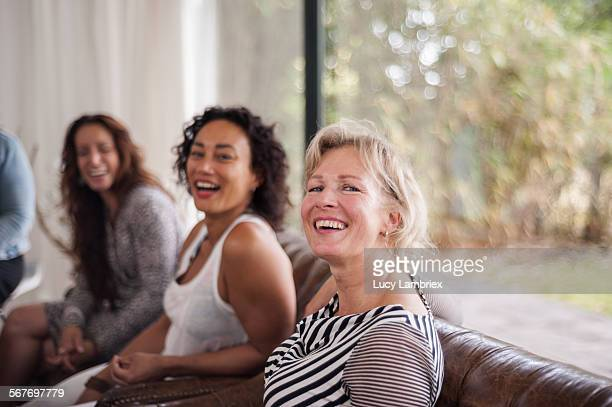 Women laughing at camera