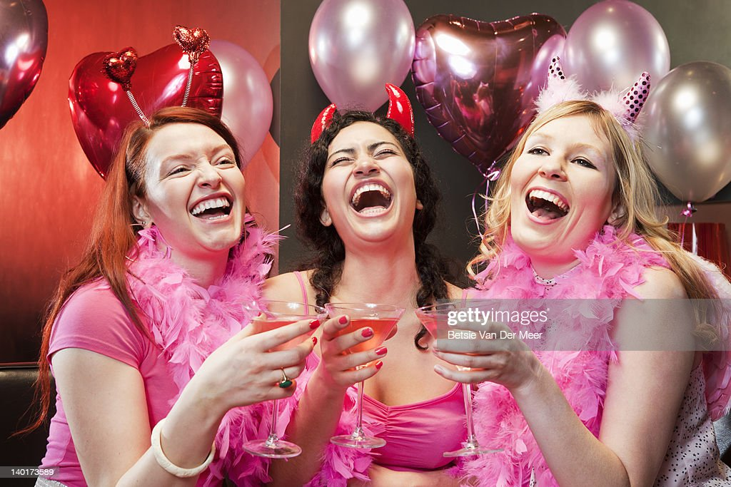 Women laughing at party. : Stock Photo