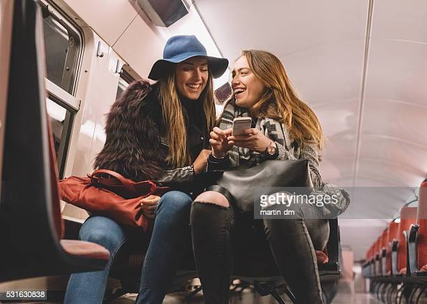 Women laughing in the subway