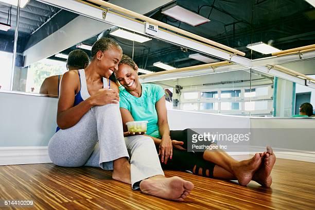 Women laughing in yoga studio