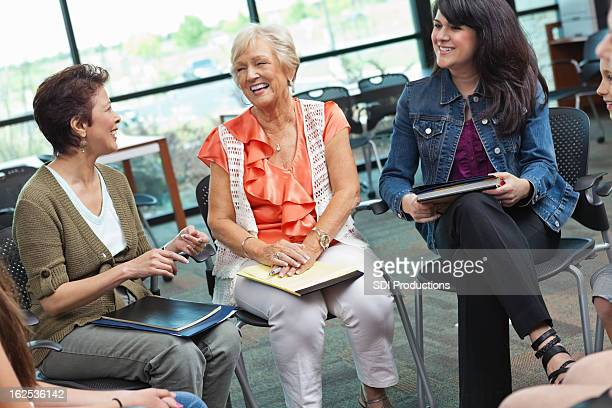 Women laughing together in a meeting