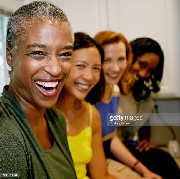 Women laughing together in kitchen