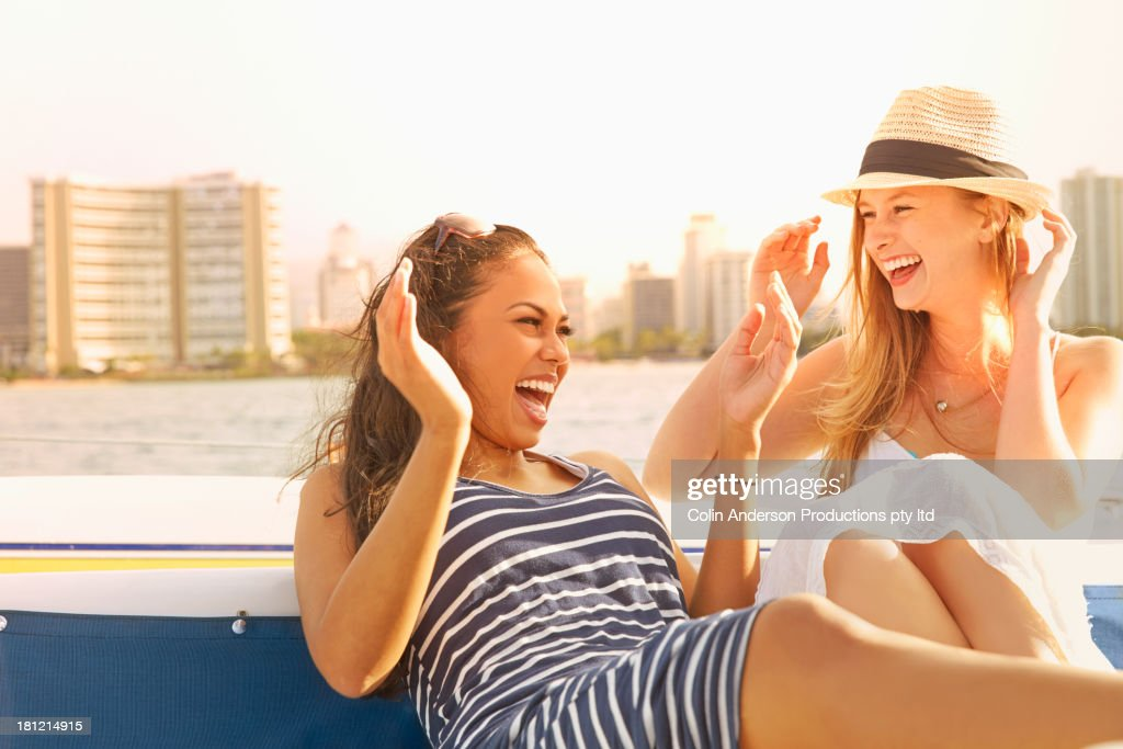 Women laughing together on boat : Stock Photo