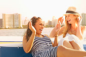 Women laughing together on boat