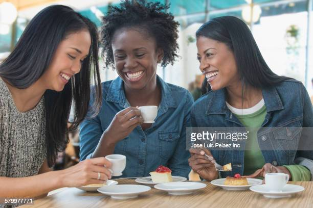 Women laughing with dessert cafe