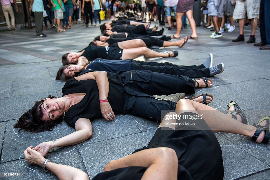 Women Lay On The Floor As If They Were Dead During A Performance Carried  Out By