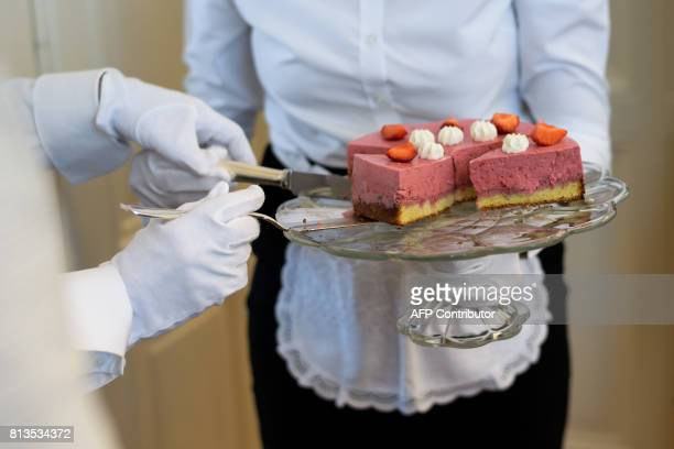 Women learn how to serve a dessert during a lesson at the Switzerland's last finishing school Institut Villa Pierrefeu on June 26 2017 in Glion Eight...