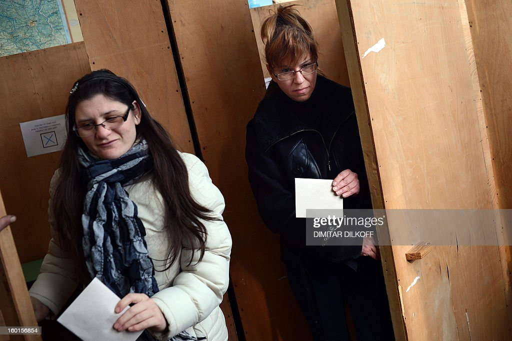 Women leave a polling booth before voting during the national referendum in the town of Belene on January 27, 2013. Bulgarians voted Sunday on whether to revive plans ditched by the government to construct a second nuclear power plant, in the EU member's first referendum since communism. The referendum asks 6.9 million eligible voters: 'Should Bulgaria develop nuclear energy by constructing a new nuclear power plant?'