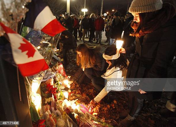 Women leave candles at the French embassy during a vigil in Ottawa on November 14 one day after the terrorist attacks in Paris Stirring renditions of...